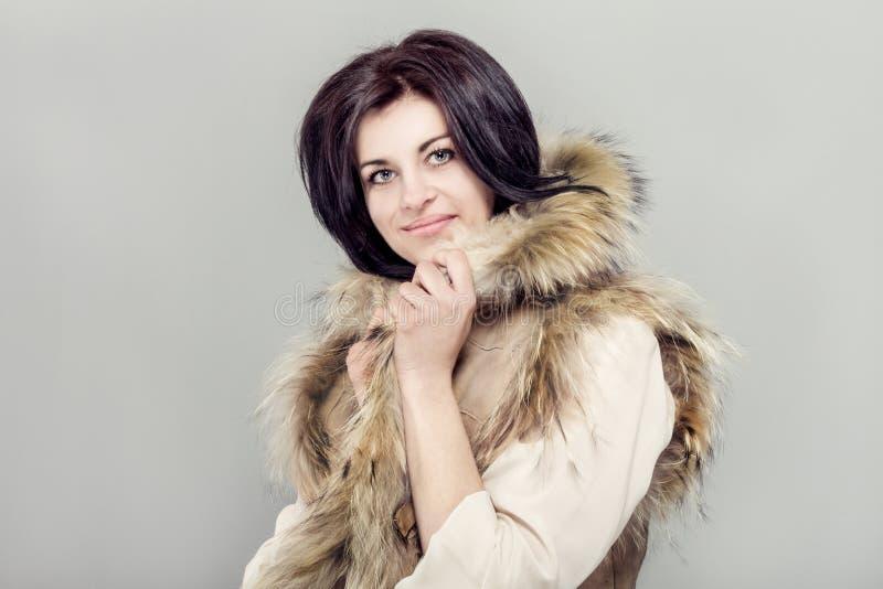 Mulher com waistcoat do inverno. foto de stock royalty free