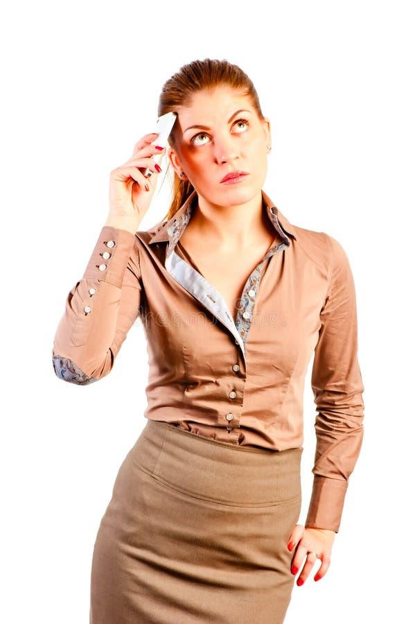 Mulher Comely com o telefone imagem de stock royalty free