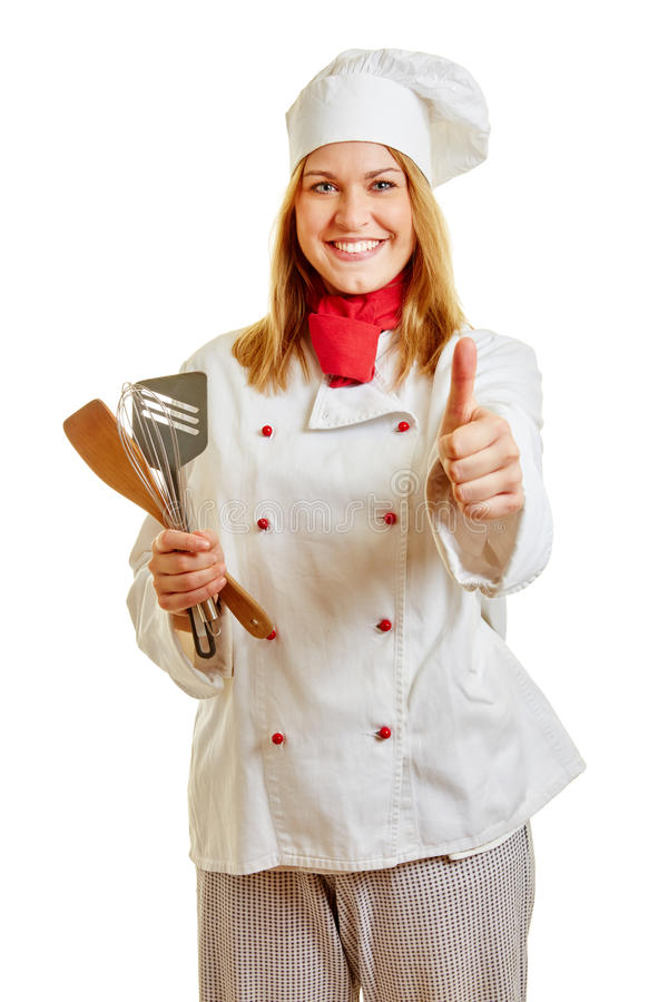 Mulher como um cozinheiro que mantém os polegares fotografia de stock royalty free