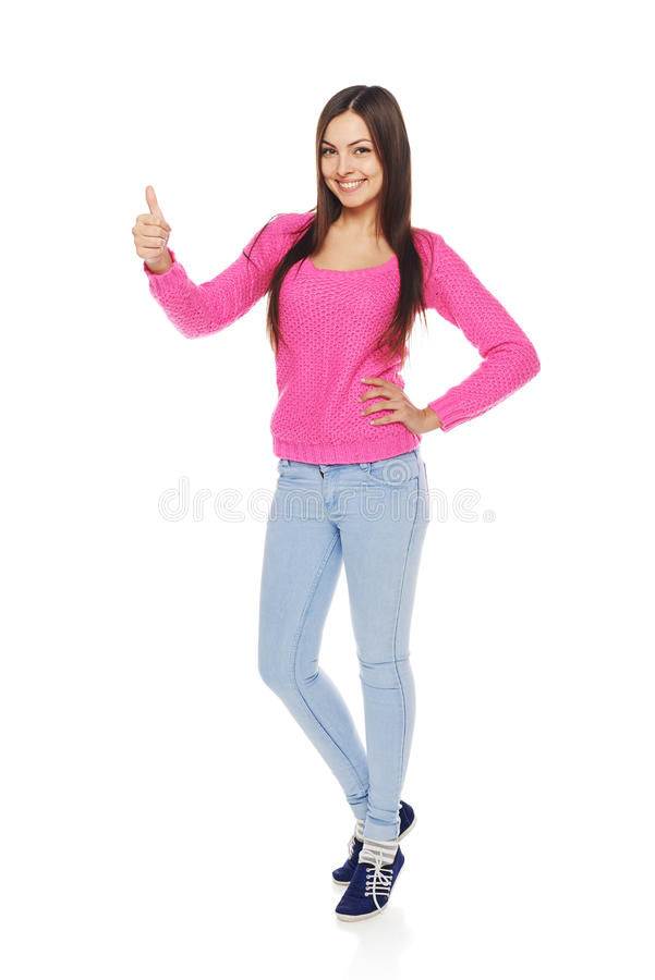 A mulher completa do corpo que mostra os polegares levanta o gesto fotografia de stock
