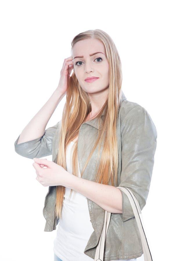 Mulher consideravelmente loura que veste Gray Blazer imagens de stock royalty free