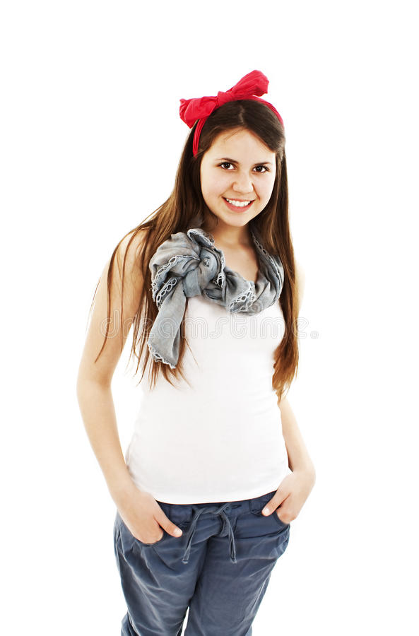 Mulher consideravelmente nova com mãos em uns bolsos fotografia de stock royalty free