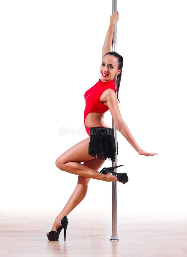 Mulher contratada na dança do polo fotografia de stock royalty free