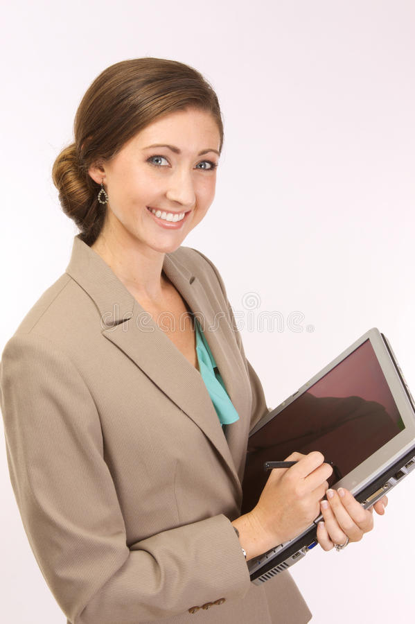 Mulher corporativa com um PC da tabuleta imagens de stock royalty free