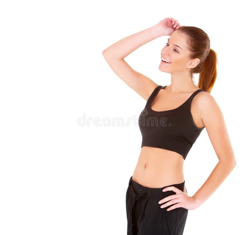 Mulher da aptidão na roupa preta dos esportes fotos de stock royalty free