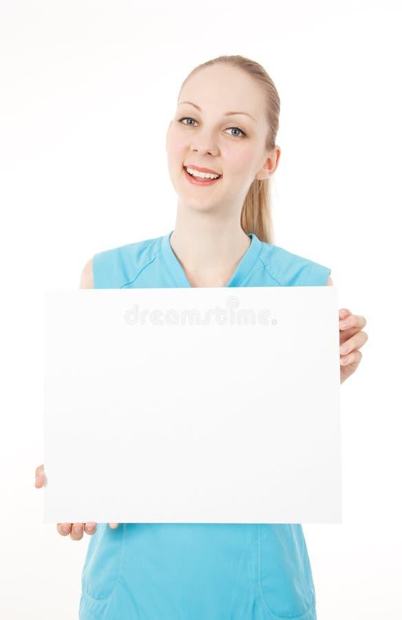 A mulher da aptidão prende o sinal em branco imagens de stock royalty free