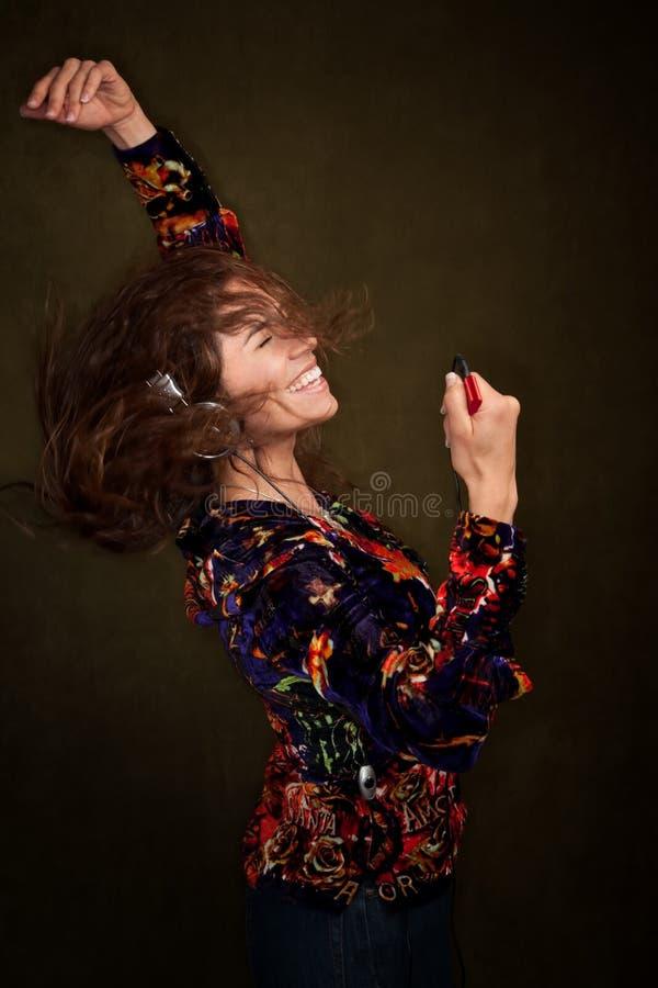 Mulher da dança com auscultadores imagens de stock