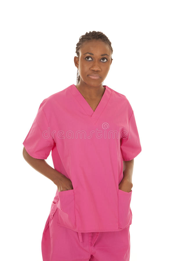 A mulher da enfermeira olha acima imagem de stock royalty free