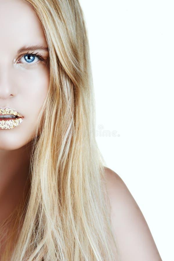 Mulher da folha de ouro fotografia de stock royalty free