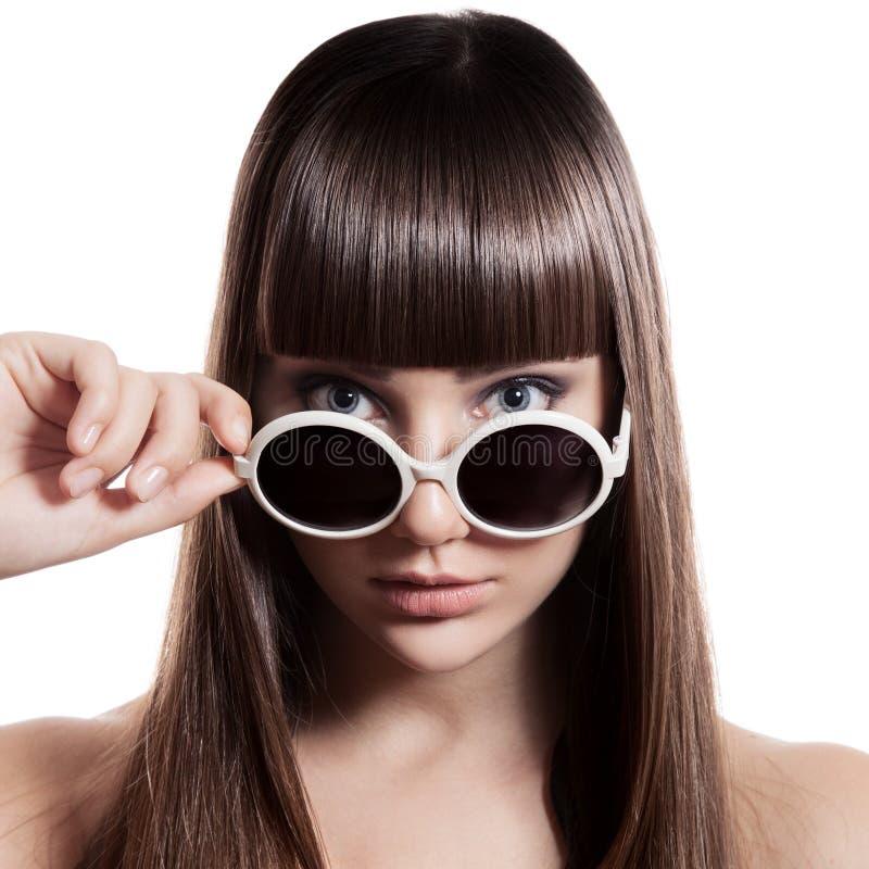 Mulher da forma com óculos de sol. Isolado imagem de stock royalty free
