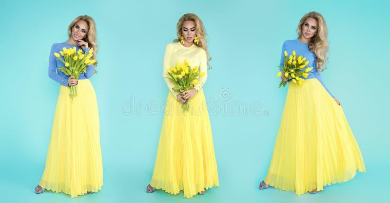 Mulher da mola Menina do modelo do ver?o da beleza com a roupa colorida, guardando um ramalhete de flores da mola Senhora bonita  imagem de stock royalty free