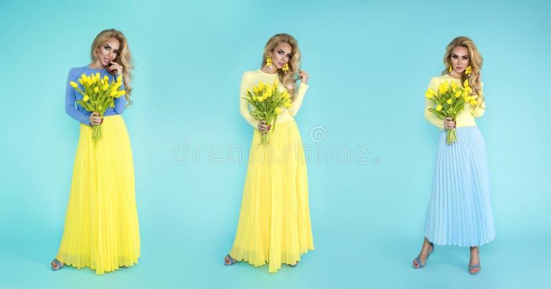Mulher da mola Menina do modelo do ver?o da beleza com a roupa colorida, guardando um ramalhete de flores da mola Senhora bonita  foto de stock royalty free