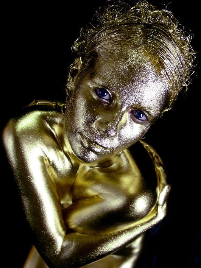 Mulher da poeira de ouro imagem de stock royalty free