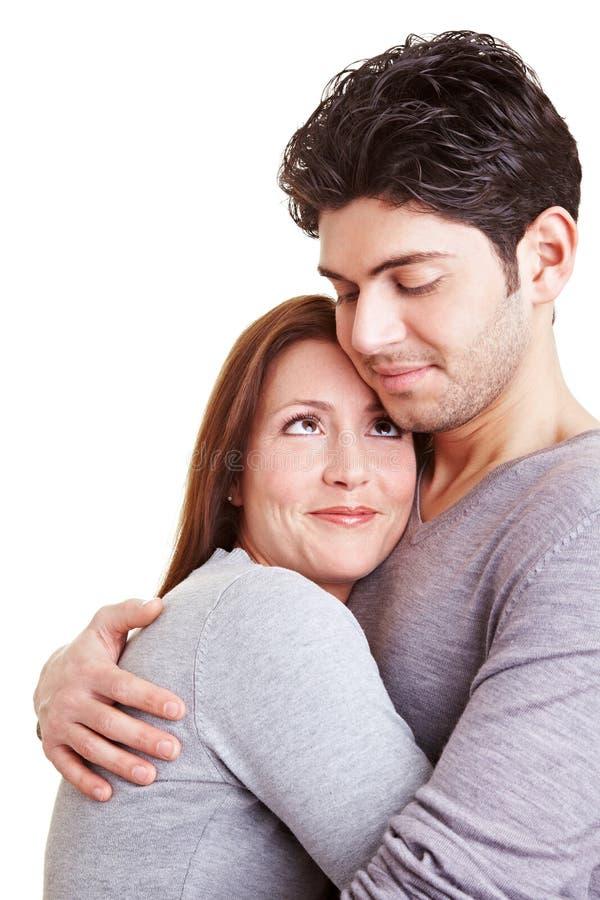 Mulher de abraço do homem imagens de stock royalty free