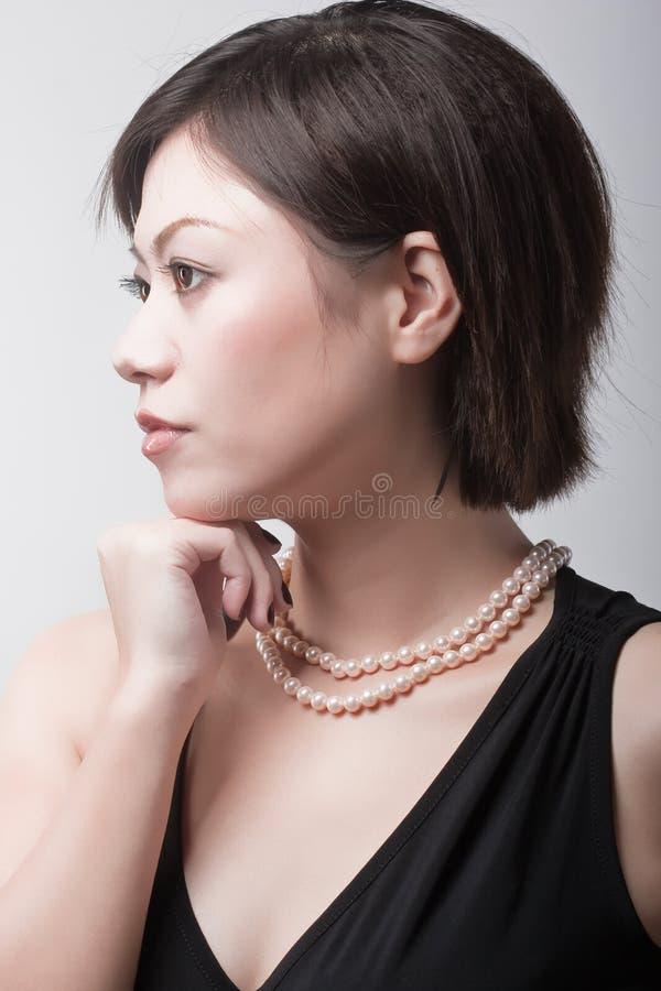 Mulher de gama alta na moda fotografia de stock