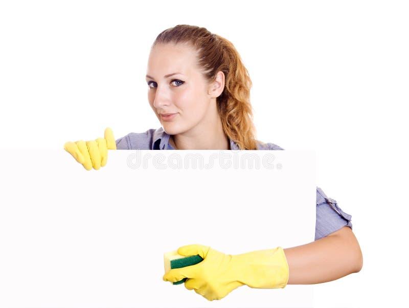Mulher de limpeza que mostra o sinal imagem de stock