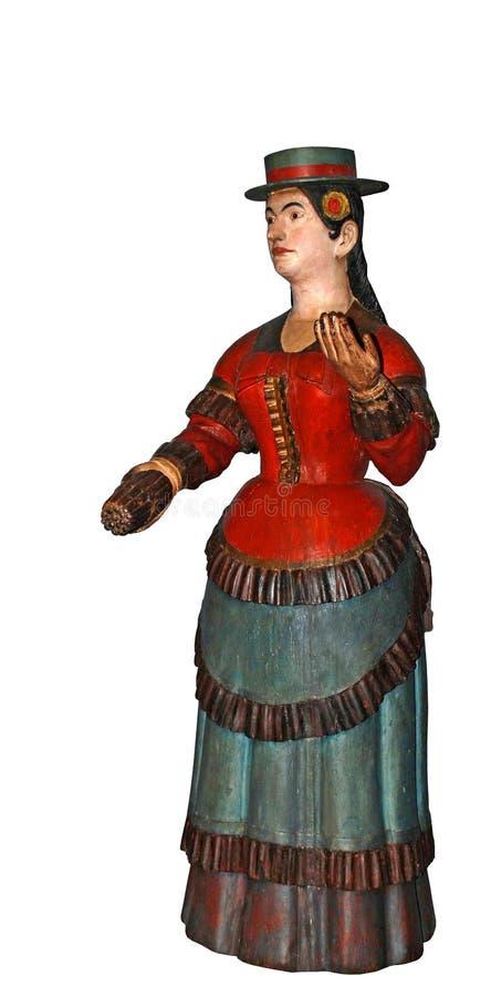Mulher de madeira mexicana do charuto do cigarro cinzelada na madeira imagem de stock royalty free