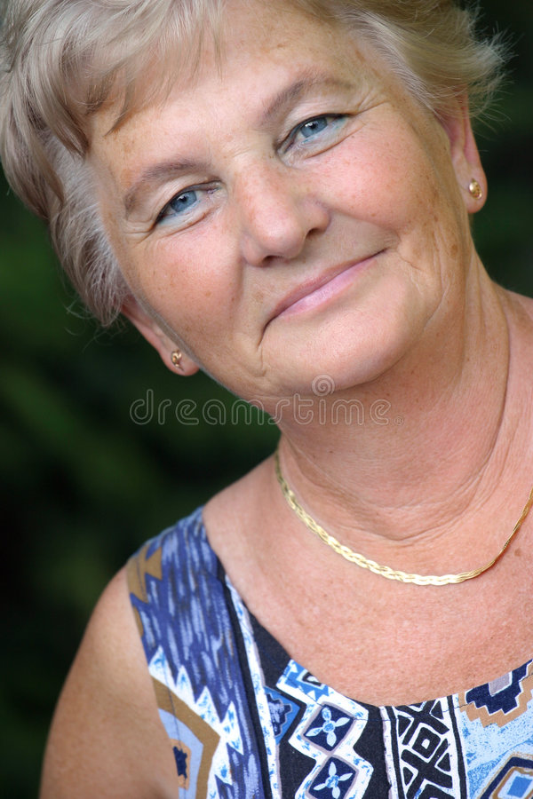 Mulher de meia idade fotografia de stock