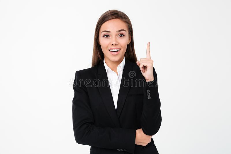 Mulher de negócio alegre que aponta ao copyspace imagens de stock royalty free