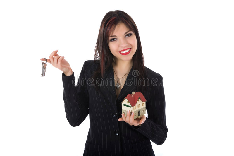 A mulher de negócio anuncia bens imobiliários foto de stock royalty free