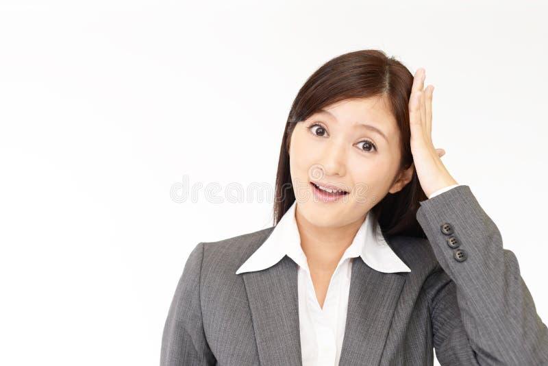 Mulher de negócio asiática surpreendida fotografia de stock