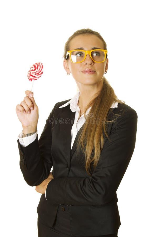 Mulher de negócio atrativa com um lollipo fotografia de stock royalty free