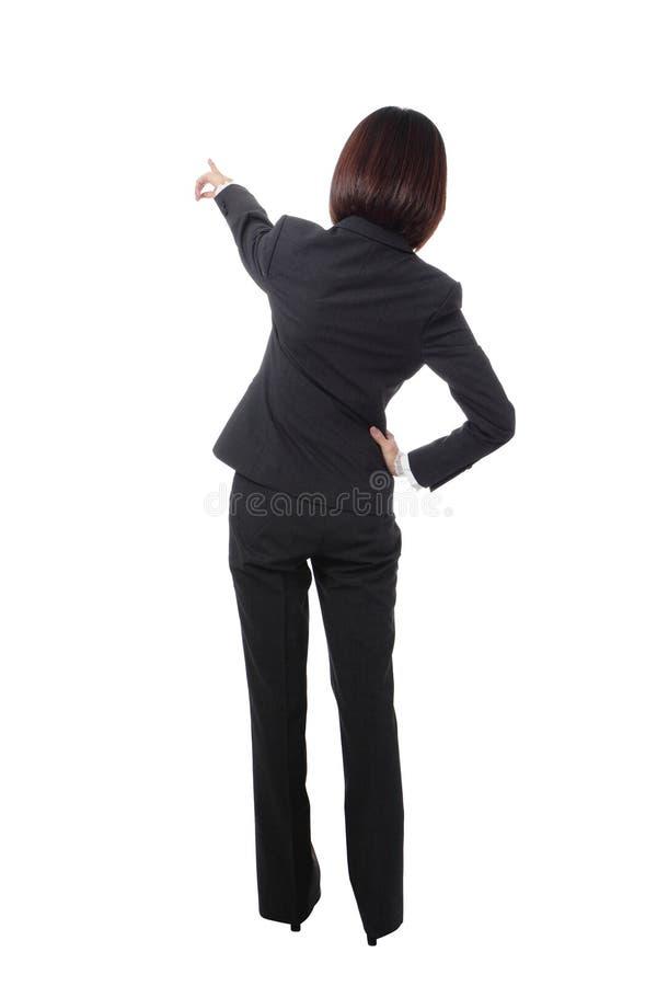 A mulher de negócio cheia do comprimento aponta o dedo dentro para trás foto de stock royalty free