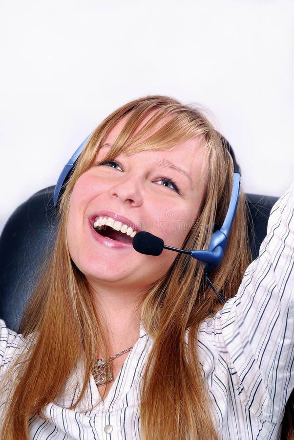 Mulher de negócio com auriculares imagens de stock