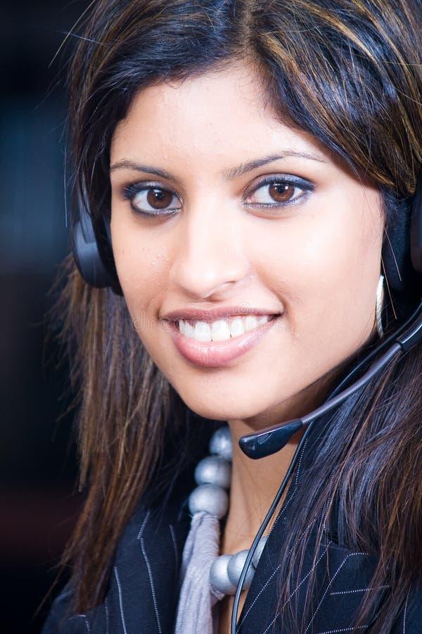 Mulher de negócio com auriculares fotografia de stock royalty free