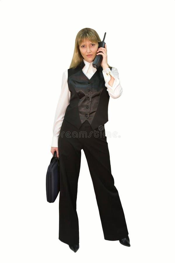 Mulher de negócio com caso e telefone fotografia de stock royalty free
