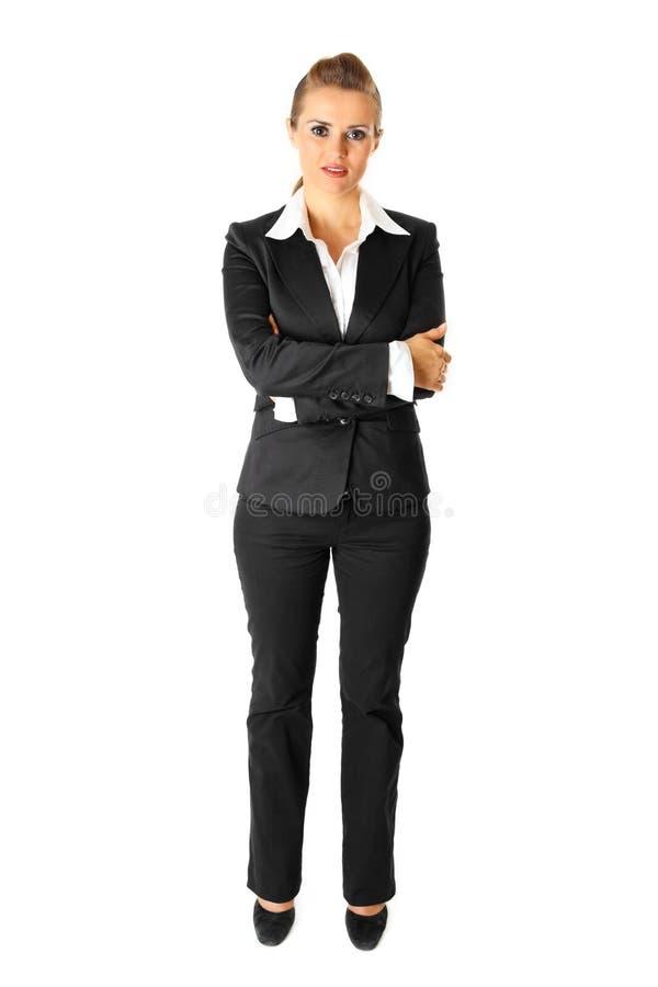 Mulher de negócio com os braços cruzados na caixa isolada imagens de stock