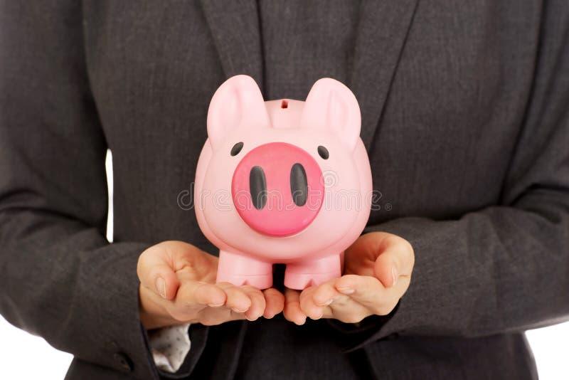 Mulher de negócio com piggybank imagem de stock