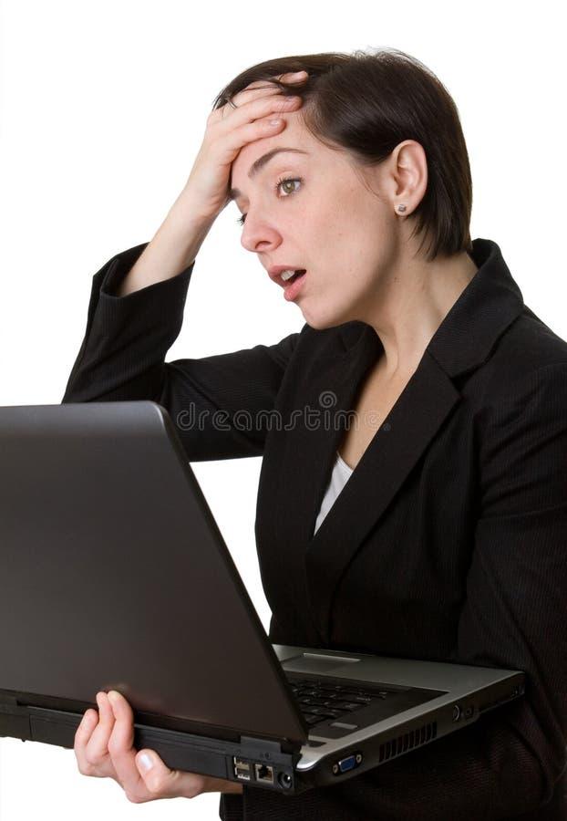 Mulher de negócio com preocupação do portátil foto de stock royalty free