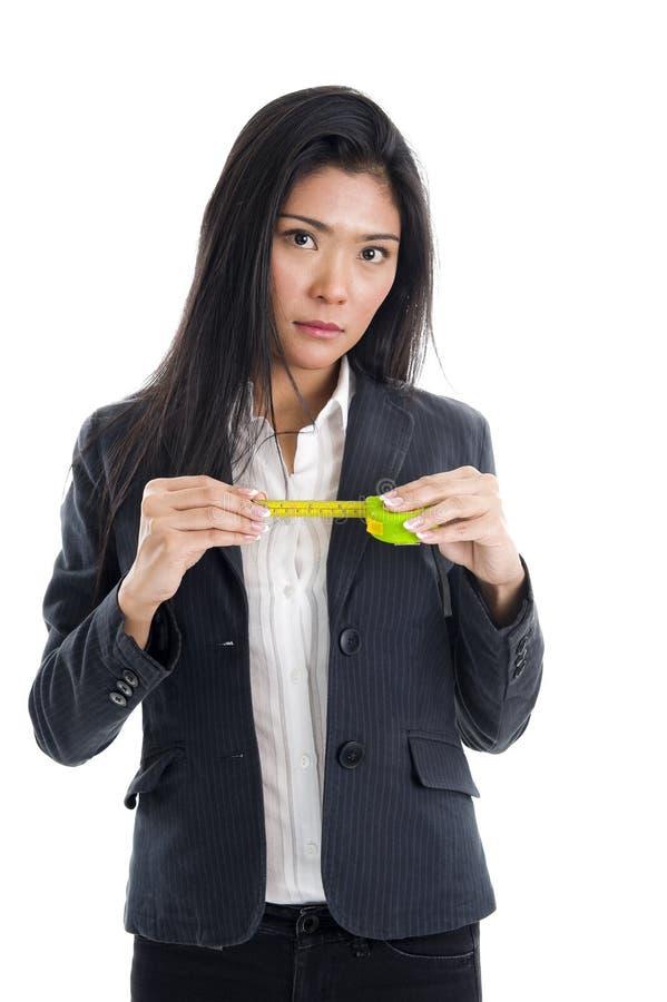 Mulher de negócio com régua imagem de stock