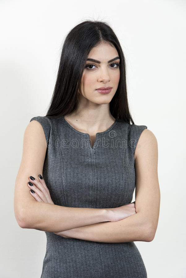 Mulher de negócio com seus braços cruzados fotografia de stock royalty free