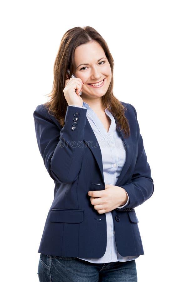 Mulher de negócio com texting do telefone celular foto de stock