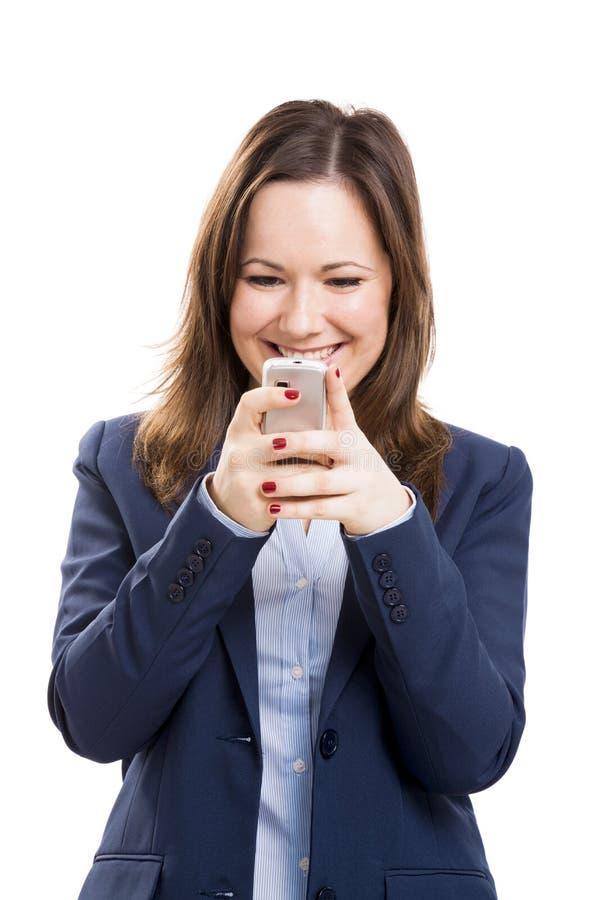Mulher de negócio com texting do telefone celular fotos de stock