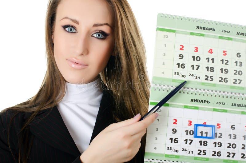 A mulher de negócio com um calendário fotografia de stock