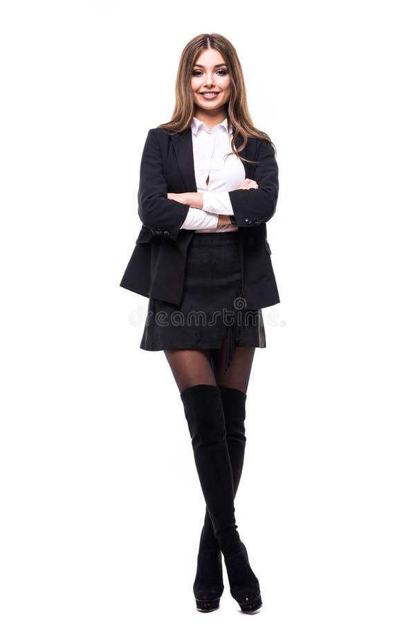 Mulher de negócio confiável que está o comprimento cheio no terno preto Mulher de negócios ou mediador imobiliário isolada no fun imagens de stock