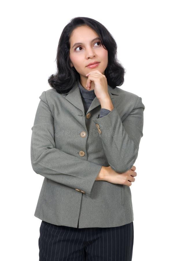 A mulher de negócio da raça misturada pensa fotografia de stock