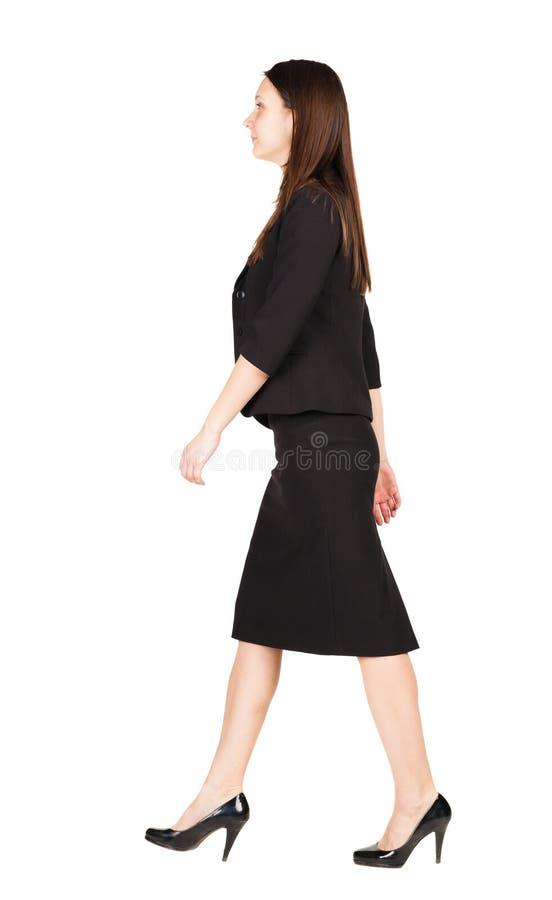 Mulher de negócio de passeio Vista traseira imagem de stock