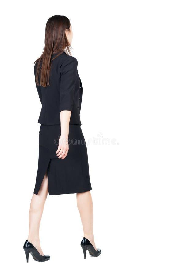 Mulher de negócio de passeio Vista traseira fotografia de stock royalty free