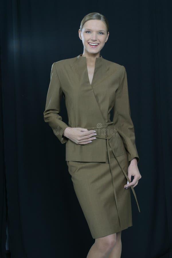 Mulher de negócio de sorriso bonita nova fotografia de stock royalty free