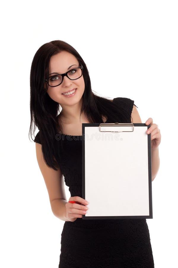 Mulher de negócio de sorriso que guardara a prancheta fotografia de stock