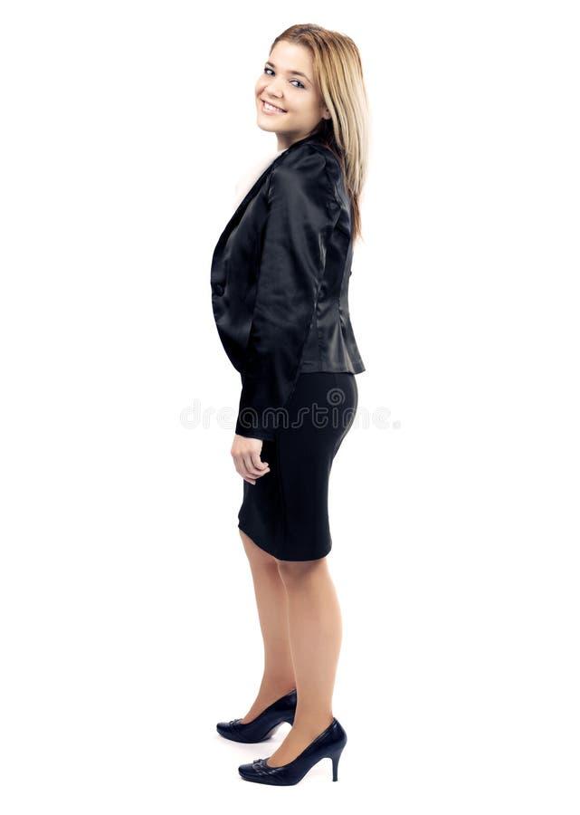 Mulher de negócio elegante que levanta e que sorri à câmera imagem de stock