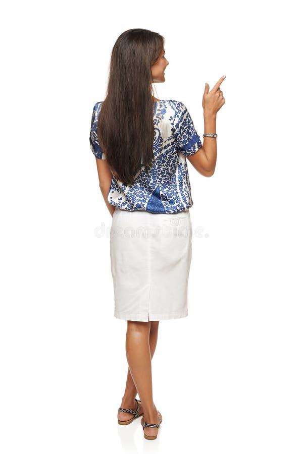 Mulher de negócio em apontar no espaço da cópia fotos de stock royalty free