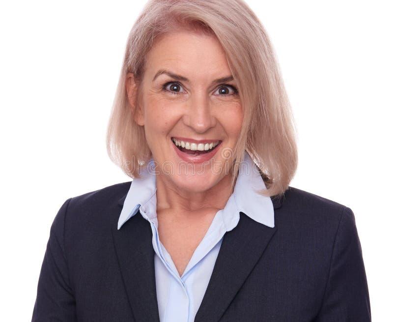 Mulher de negócio envelhecida média feliz fotografia de stock