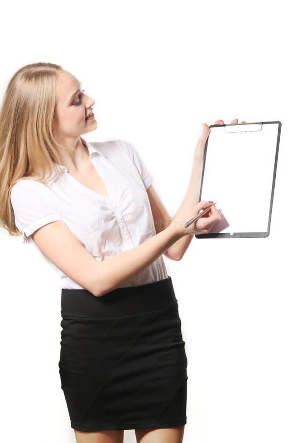 A mulher de negócio escreve na prancheta isolada no branco fotografia de stock royalty free