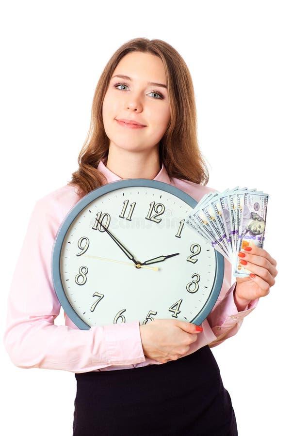 A mulher de negócio está realizando nas mãos cronometra e dinheiro Dólares do tempo imagem de stock