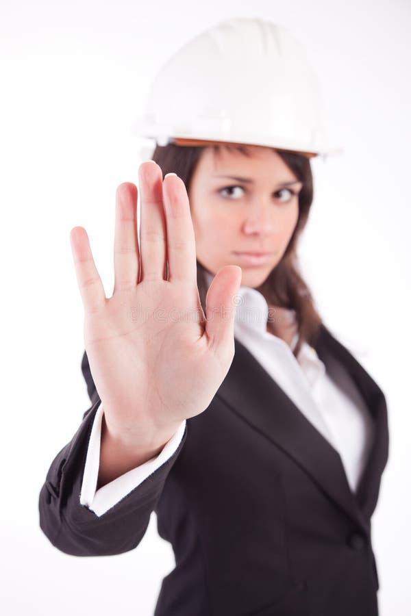 Mulher de negócio, fazendo o sinal do batente fotografia de stock